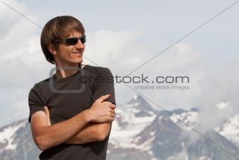 Young man high in the mountains