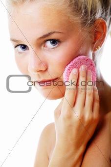 Beautiful woman removing make-up