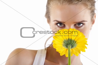 smelling a yellow flower
