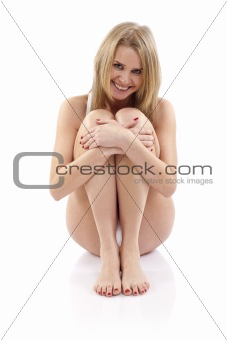 woman sitting hugging legs