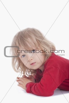 boy with long blond hair looking at camera - isolated on white