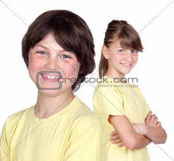 Adorable preteen girl and little boy in yellow
