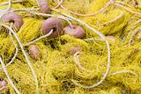 Tangled fishing tackle: net, float, rope close-up