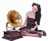 pretty girl listening music on old gramophone
