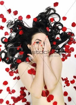 beautiful young nude woman with roses isolated on white