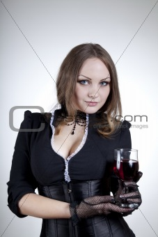 Aristocratic woman with glass of wine