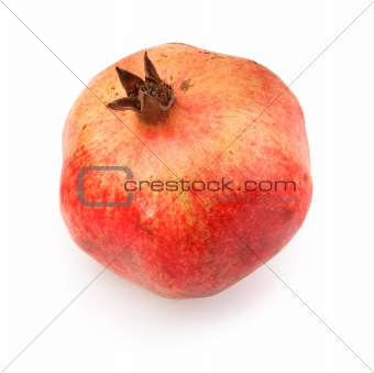 single ripe pomegranate fruit