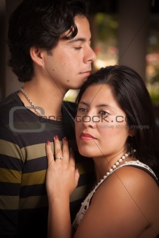 Attractive Hispanic Couple Portrait Enjoying Each Other Outdoors.