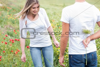 boyfriend hiding a flower