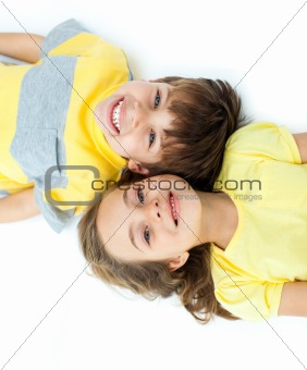 Adorable children lying on the floor