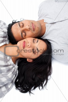 Intimate couple lying on the floor