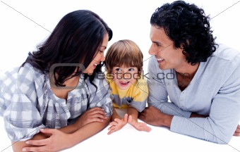 Attentive young parents with their son lying on the floor