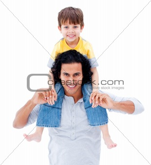 Caring father giving piggyback ride to his  little boy