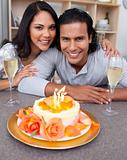 Cheerful man and his wife celebrating his birthday in the kitchen