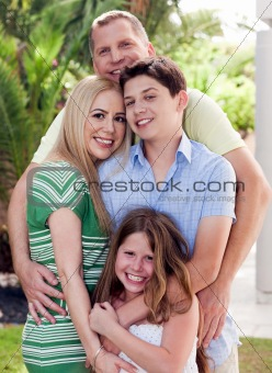 Portrait of loving father holding his family