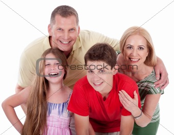 Happy family smiling towards the camera