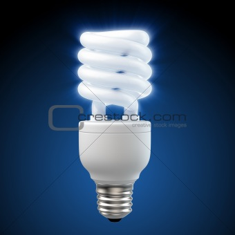 White energy saving light bulb on blue