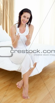 Atractive woman finding out results of a pregnancy test