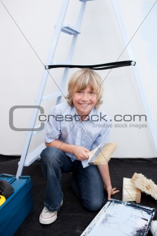 Portrait of little boy renovating home