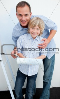 Happy father and his son renovating home
