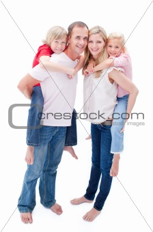 Attentive parents giving their children piggyback ride
