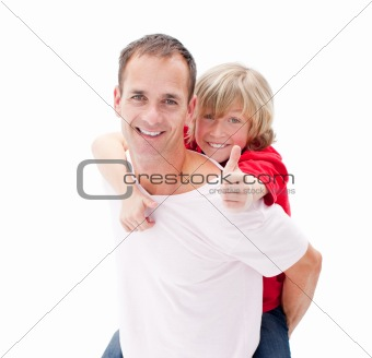 Blond little boy enjoying piggyback ride with his father