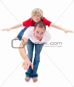 Adorable child enjoying piggyback ride with his father