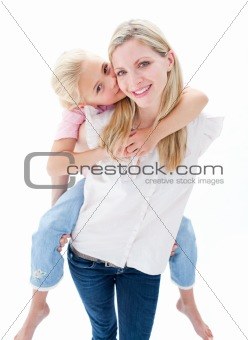 Portrait of little girl enjoying piggyback ride with her mother