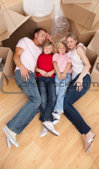 Tired family sleeping lying on the floor