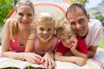 Portrait of a happy family lying on the grass