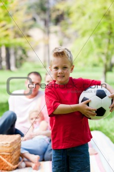 Little boy holding a soccer ball