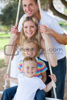 Jolly family swinging