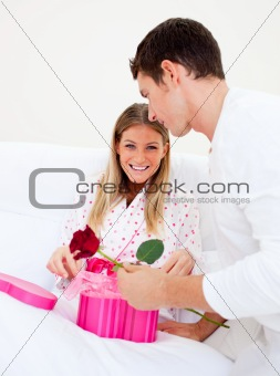 Attractive husband giving a present to his wife