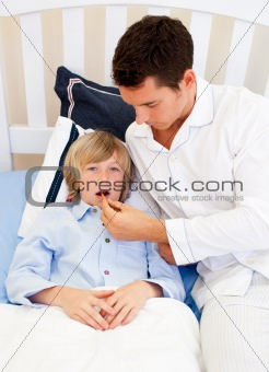 Affectionate father checking his son's temperature