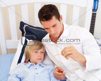 Portrait of an attractive father checking his son's temperature