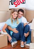 Caucasian couple embracing after move in
