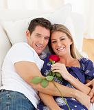 Romantic lovers relaxing on sofa
