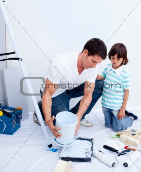 Attentive father and his son decorating their house
