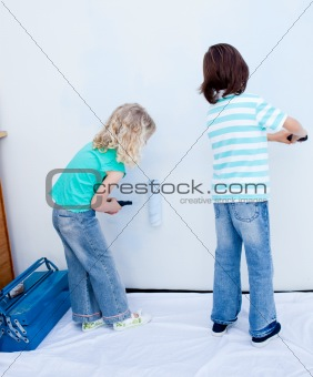 Two loving siblings decorating their house