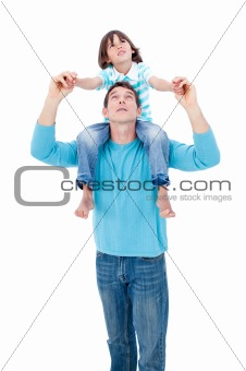 Merry little boy enjoying piggyback ride with his father