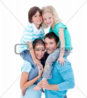 Loving parents giving their children piggyback ride