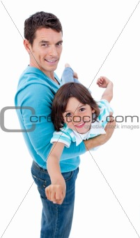 Charming father giving his son piggyback ride