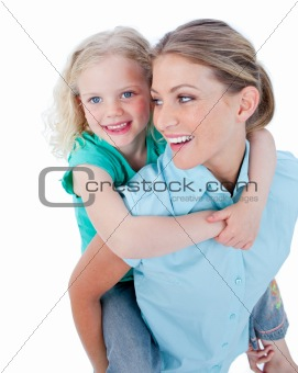 Caucasian mother giving her daughter piggyback ride