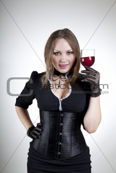 Attractive woman tasting red wine
