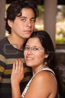 Attractive Hispanic Couple Portrait Enjoying Each Other Outdoors.