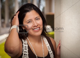 Attractive Smiling Hispanic Young Adult Woman Portrait Outside.