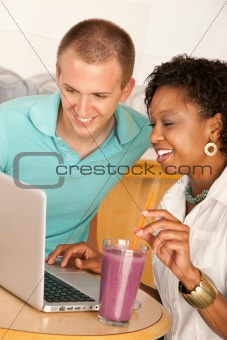 Couple Dining Out Using a Laptop