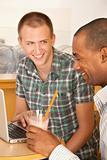 Two Men at Cafe Using Laptop