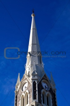 Church tower against blue sky