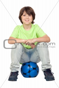 Adorable child sitting on blue soccer ball